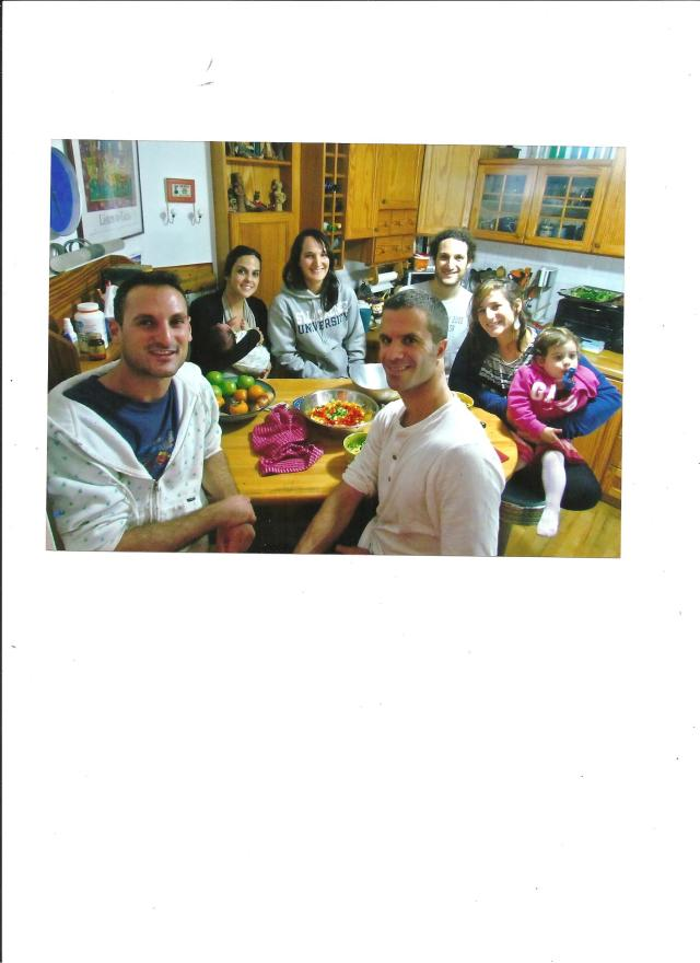 At the kitchen table, reenacted a few years later. Back row, Libi, with Eyal, her son who's now two, Amalia, Ari, Libby with Abigail, Izzy and Shlomie.