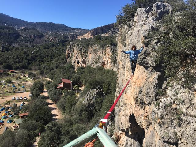 Here's total trust. That's Ari walking on a highline in Turkey. He's got a harness on. But still.