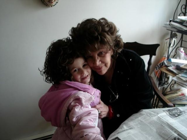 My mother with her granddaughter, Ruby, who's wearing one of my mother's wigs.
